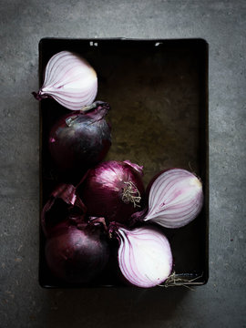 Red onions in tin dish