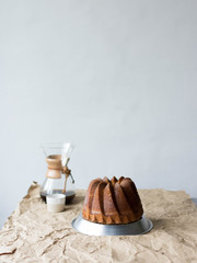 Bundt cake and Chemex coffee on table