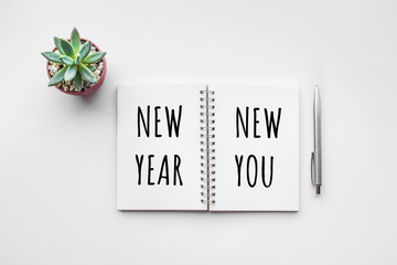 New year new you text on notepad with office accessories.Business motivation,inspiration.