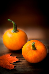 Happy Thanksgiving Day background - orange pumpkins over wooden table. Autumn nature concept..