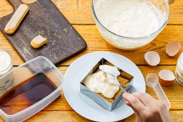 Photo of cooking tiramisu from cookies, cream cheese