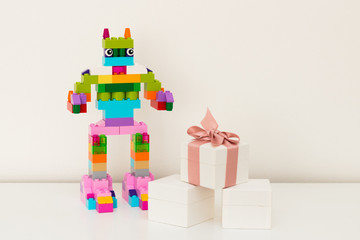New Year And Christmas Card And Congratulations Robot From Cubes Of