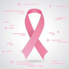 Pink breast cancer awareness ribbon isolated on a grey background