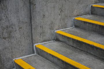 Orange paint stripes on concrete steps