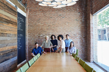 Group portrait of millennials at start up business