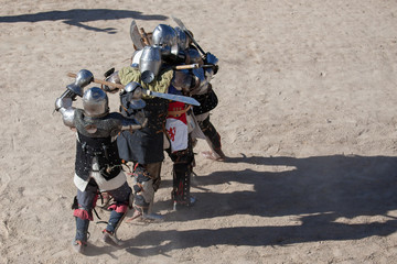 Men in a medieval battle. They are protected by armors from the 14th and 15th centuries                                                                              Medieval Wrestling Combat