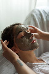 Portrait of a woman relaxing with an argil facial mask