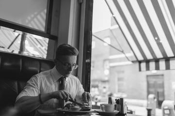 Young Entrepreneur Having English Breakfast in Coffee Shop