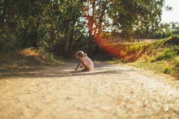 child waiting in the middle of the road