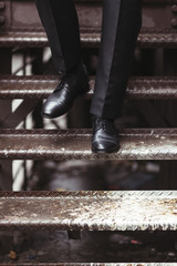 Closeup of a business man's shoes as he's walking down the stairs