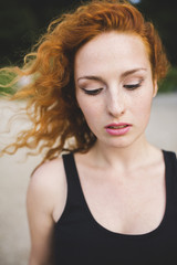 Portrait of a ginger haired woman