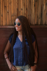 Portrait of a Smiling Young Woman with Sunglasses