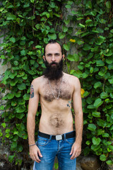 Shirtless Man With the Beard Standing in Nature