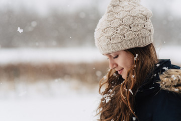 A young girl playing in the snow