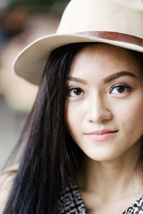 beautiful young woman in hat