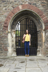 Young woman at the gate.
