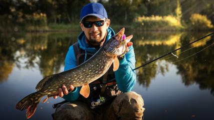 Fishing. Fisherman and trophy Pike.