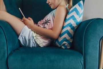 Girl Using a Tablet at Home