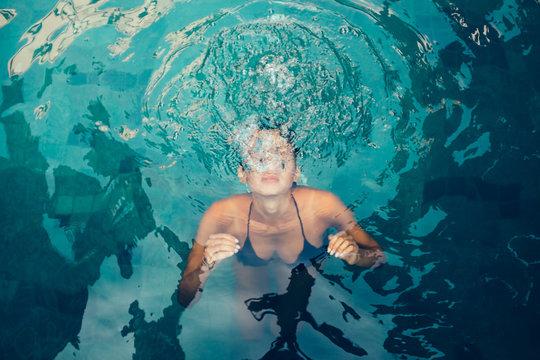 Tanned Caucasian Woman Underwater