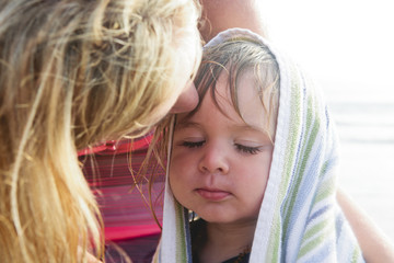Boy Wrapped in Towel, Mom Giving Kiss