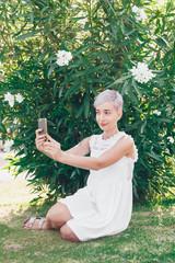 Portrait of a beautiful woman taking a selfie