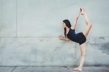 Profile of Young Beautiful Ballerina With Her Leg Up