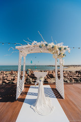 festive wedding ceremony on a background a sea. Registration of holiday is in violet and blue colors