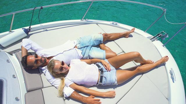 Beatiful couple in yacht