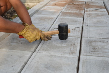 Man with Rubber Mallet Paving
