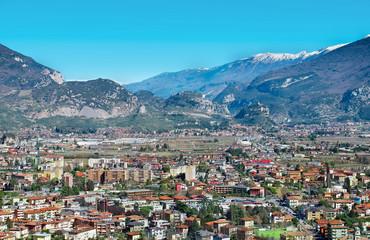 Riva del Garda, Italy - Mart 10, 2017: Beautiful panoramic view on Riva del Garda, snowy mountains near Lake Garda and Arco Castle