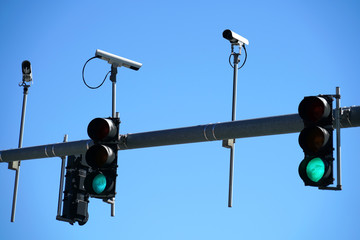 Traffic light and surveillance camera