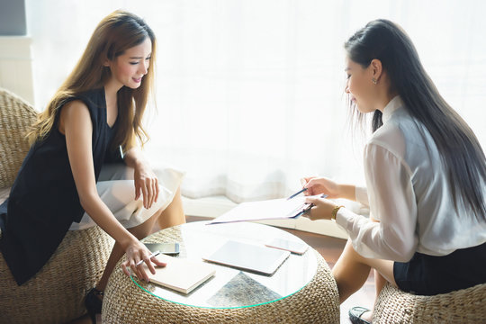 Businessperson Signing Contract about insurance, Two women writing with pen sign of modest agreements form In modern office, morning light, vintage color, success of business partners concept