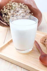 Milk in glass on wooden background