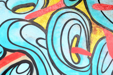 Background image with a graffiti pattern, which is applied to a concrete wall with aerosol paints