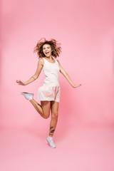 Full length portrait of a joyful girl in summer dress