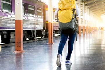 woman with her backpack walking in train station