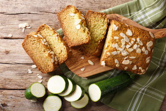 Sliced zucchini bread with almonds close-up. horizontal top view