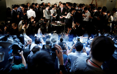 Tokyo Governor Koike and Democratic Party leader Maehara attend a news conference after their talks in Tokyo