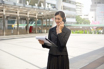 Business woman discussion outdoor on the phone