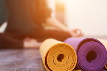 Printed kitchen splashbacks Yoga school Closeup view of yoga mat and woman on background