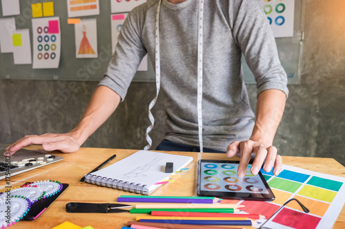 Men Working As Fashion Designer Choosing On Colour Chart For Clothes
