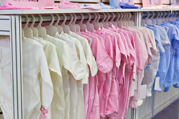 Rompers and bodysuits for newborns in store