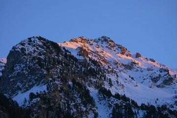 Snow mountains at sunset