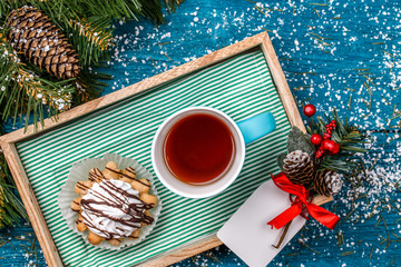 Christmas photo of tray with tea and cakes