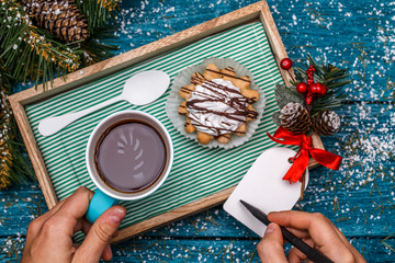 New Year's photo of tea with picture of candycane and cakes