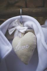 Love written in heart hanging on hanger