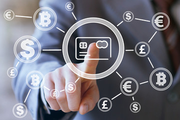 Businessman presses button credit card web dollar currency Initial Coin Offering on virtual electronic user interface.