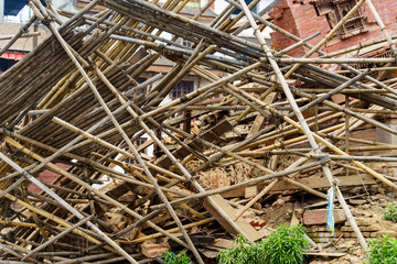 Aftermath of Nepal earthquake 2015, collapsed bamboo scaffolding and temple on Durbar Square in Kathmandu