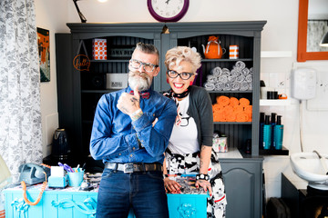 Couple in vintage clothes in quirky hair salon