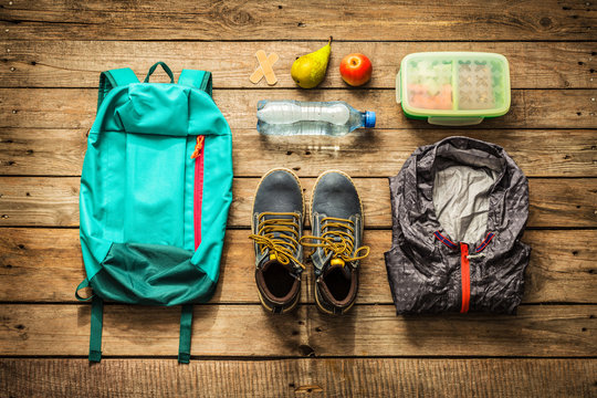 Traveling - packing (preparing) for adventure trip concept